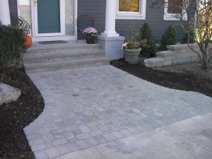 PRECAST BLOCK STEPS WITH TUMBLED BRICK PAVER WALK